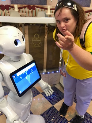Shona interacts with a robot that has an interactive screen on its chest