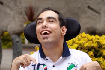 NDIS participant Troy smiling and laughing