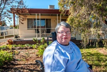 Tammy Murray outside her home.