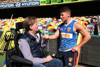John talks with Brisbane Lions AFL player
