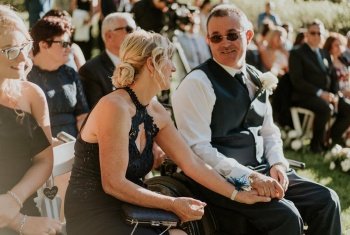 Steven sits after his proudest moment of walking his daughter down the aisle